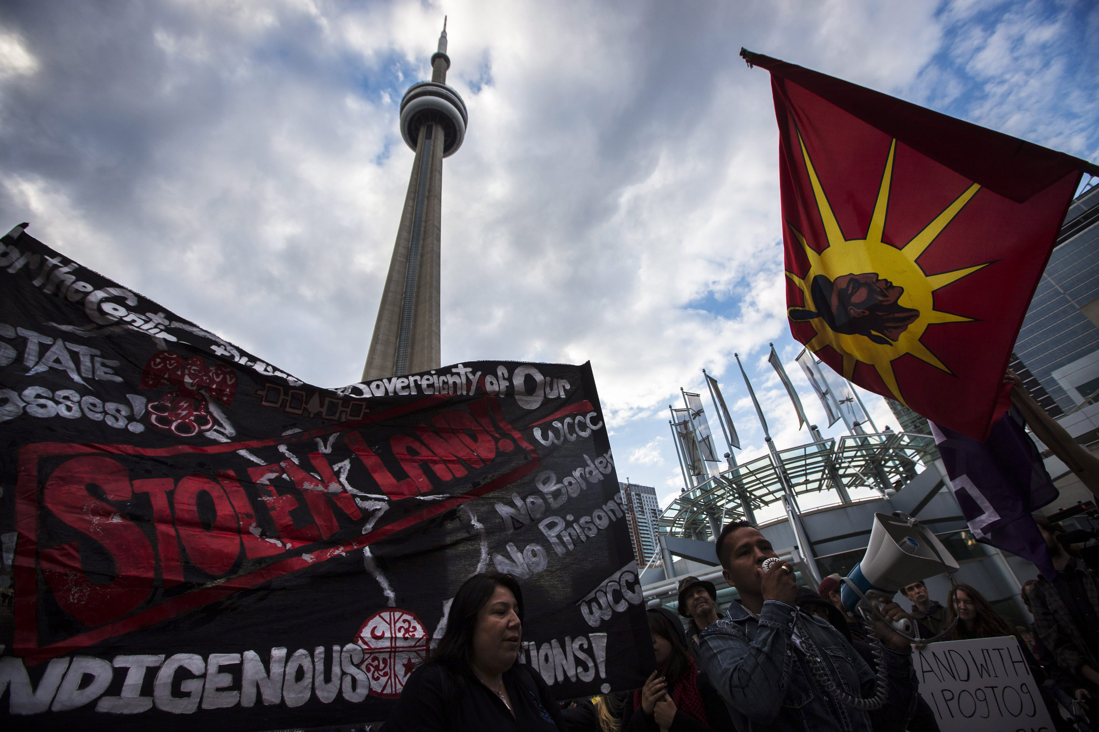 In this Friday, Oct. 18, 2013 photo, indigenous people protest outside the National Energy Board public hearings on Enbridge Line 9 oil pipeline, in Toronto. Canada is facing a crisis over aboriginal issues despite years of efforts to overcome tensions and address social problems, a U.N. expert who recently visited the country said Monday, Oct. 21, 2013. (AP Photo/The Canadian Press, Mark Blinch)